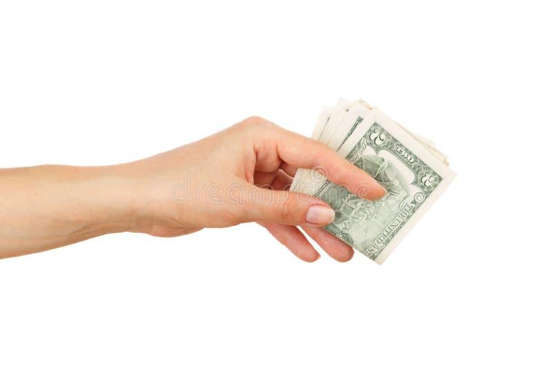 Twee dollars in de geïsoleerde vrouwen` s hand, royalty-vrije stock foto