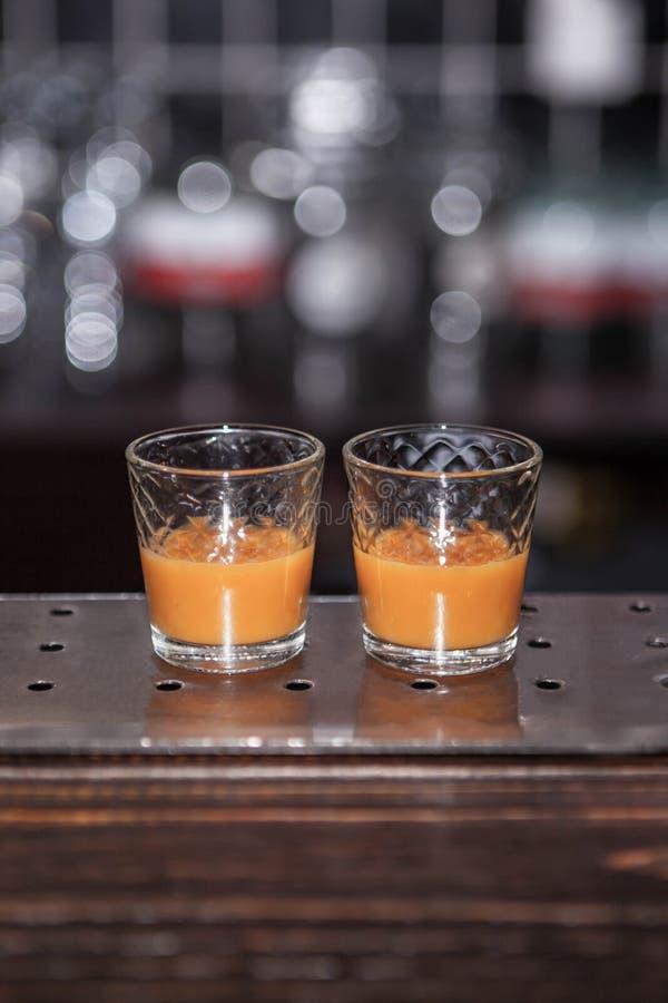 Twee duindoornschoten op een bar royalty-vrije stock afbeeldingen