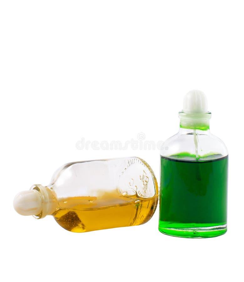 Twee flessen met aromatische oliën stock foto