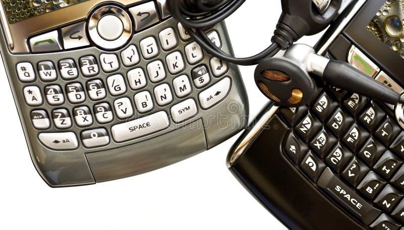 Twee geïsoleerde apparaten PDA stock afbeeldingen