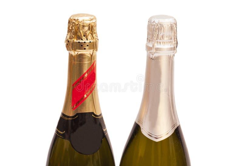 Twee geïsoleerde champagneflessen royalty-vrije stock afbeelding