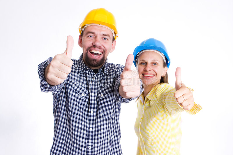 Twee gelukkige architecten of bouwers stock foto's
