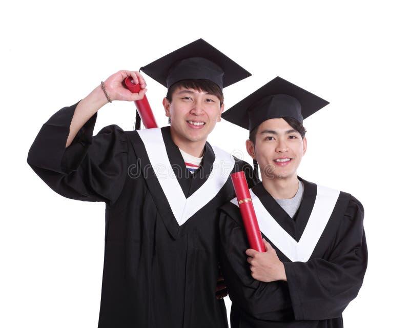 Twee gelukkige gediplomeerdenstudent royalty-vrije stock foto's
