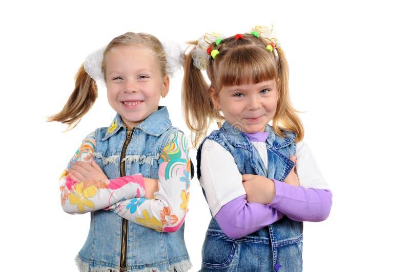 Twee glimlachende meisjes stock foto
