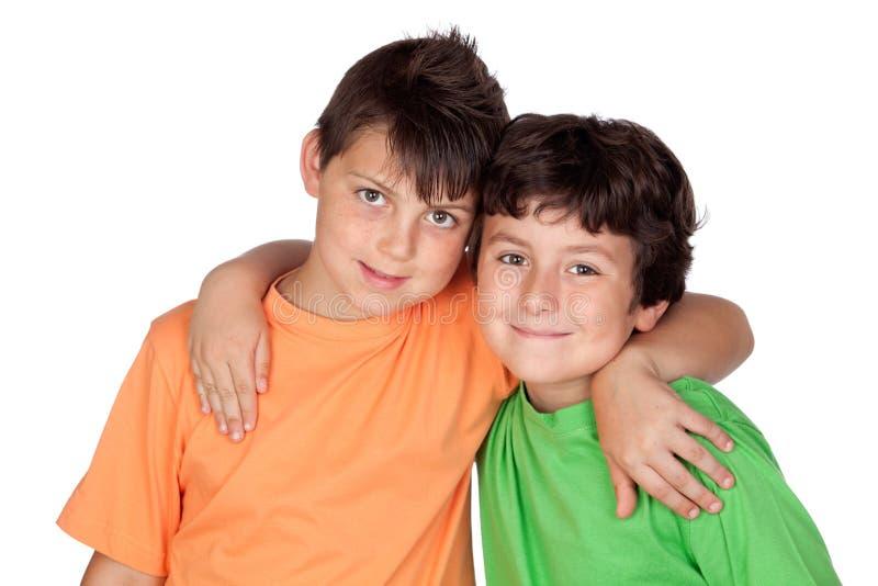 Twee grappige kinderen stock afbeeldingen