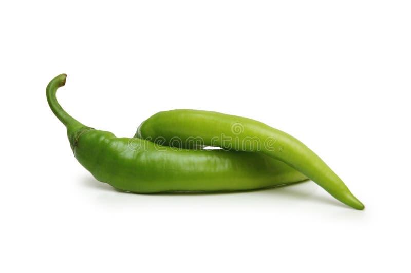 Twee Groene Geïsoleerde Spaanse Pepers Stock Afbeelding