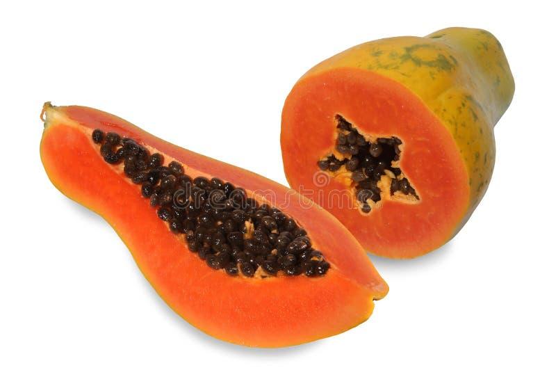 Twee halve papajabesnoeiing stock foto's