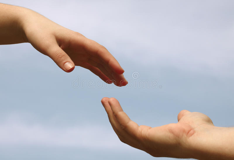 Twee handen stock afbeeldingen
