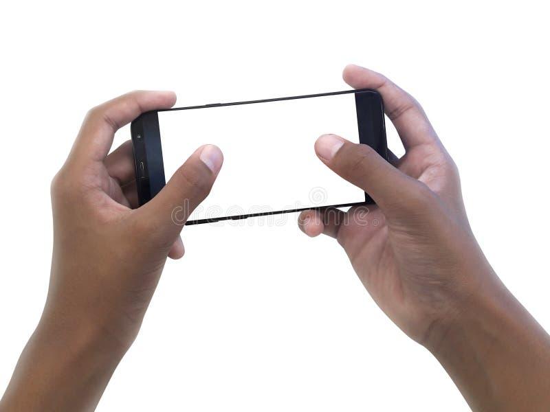 Twee handen die grote het scherm slimme telefoon houden, knippend weg stock fotografie