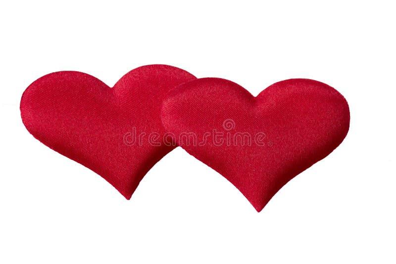 Twee harten op een witte achtergrond stock foto's