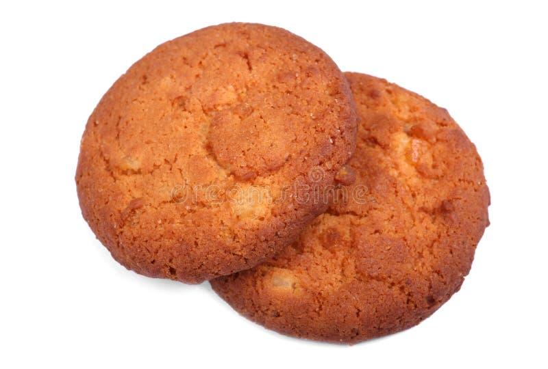 Twee havermeel, zoete, eigengemaakte koekjes, die op een witte achtergrond worden geïsoleerd De producten van de bakkerij De sand royalty-vrije stock fotografie