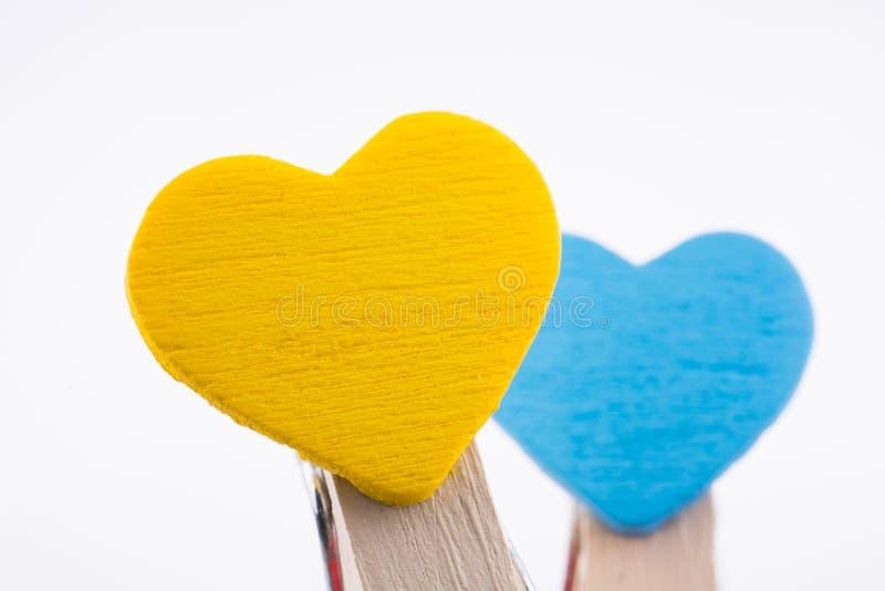 Twee hearted klemmen stock foto's