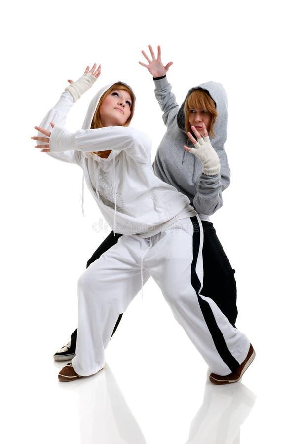 Twee het jonge vrouwen dansen stock afbeelding