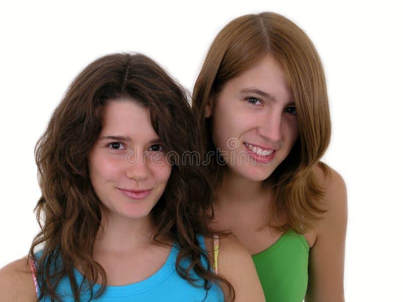 Twee het jonge vrouwen glimlachen royalty-vrije stock afbeelding