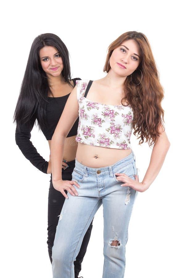 Twee het mooie jonge meisjes stellen stock foto's