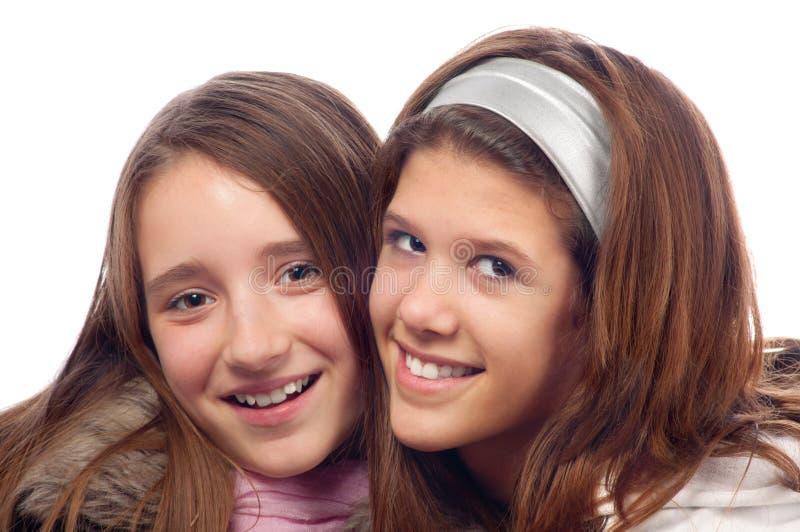 Twee het mooie tieners glimlachen royalty-vrije stock fotografie