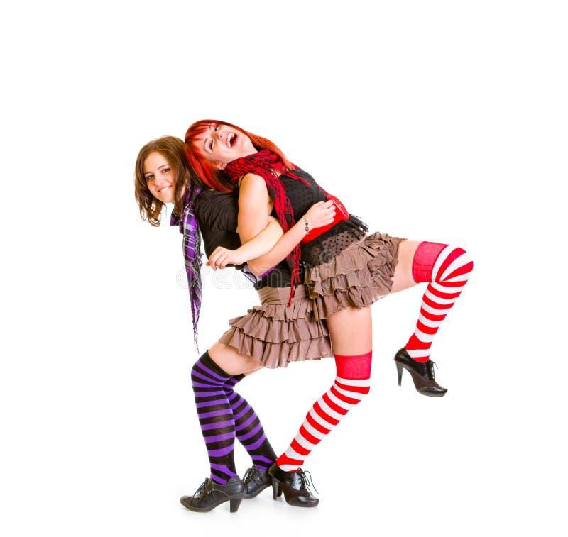 Twee het vrolijke meisjes grappige samen stellen stock afbeeldingen
