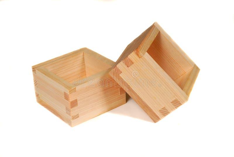 Twee houten belangenkoppen die op wit worden geïsoleerdg royalty-vrije stock afbeeldingen