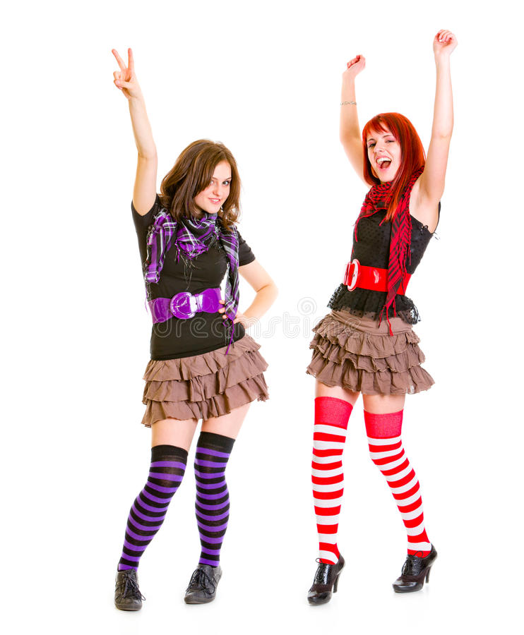 Twee jonge gelukkige meisjes die van succes genieten stock foto's