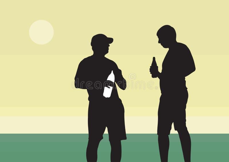Twee jonge kerels drinken een drank van een fles stock foto