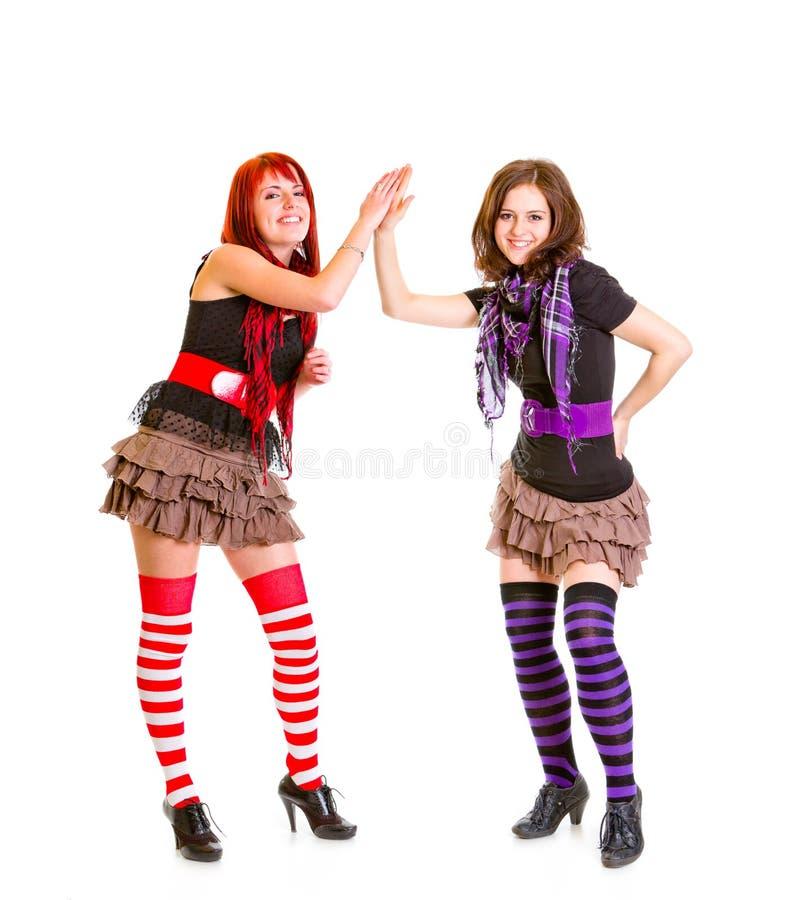 Twee jonge meisjes die handen slaan royalty-vrije stock afbeeldingen