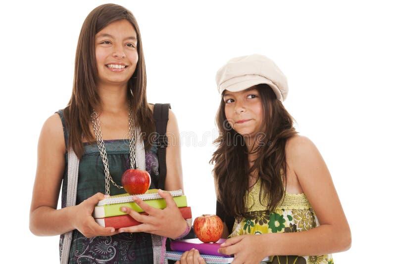 Twee jonge studentenzusters royalty-vrije stock foto