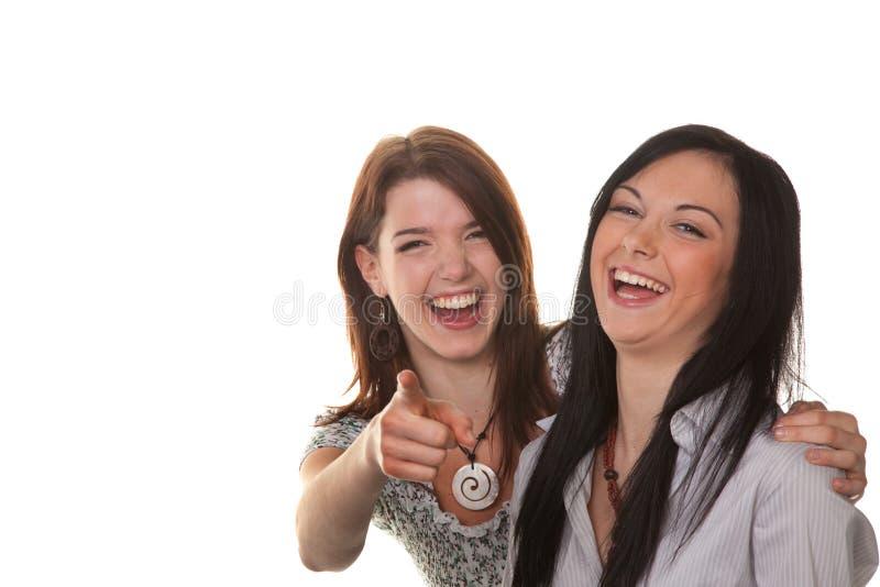 Twee jonge vrouwenuitbarsting royalty-vrije stock afbeeldingen