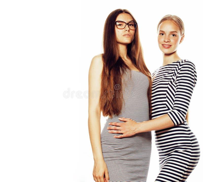 Twee jonge werknemers op witte, zelfde kleding in strook royalty-vrije stock foto