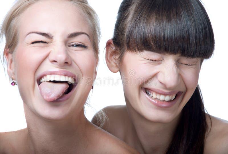 Twee leuke lachende meisjes stock fotografie