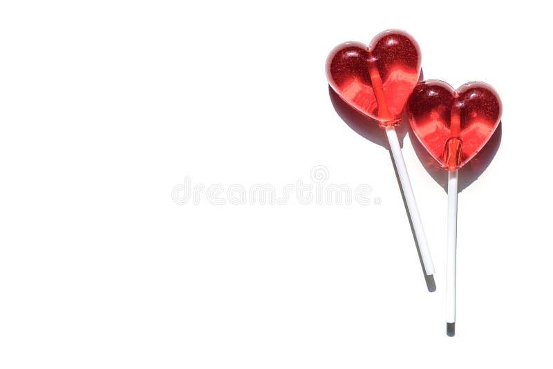 Twee Lollys Twee Harten Suikergoed Het concept van de liefde De dag van de valentijnskaart royalty-vrije stock afbeelding