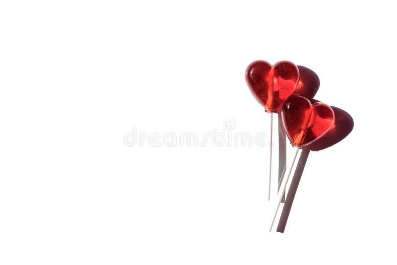 Twee Lollys Twee Harten Suikergoed Het concept van de liefde De dag van de valentijnskaart royalty-vrije stock afbeeldingen