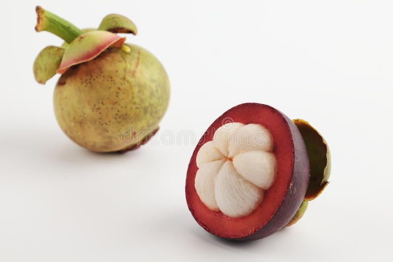 Twee mangostans stock afbeelding