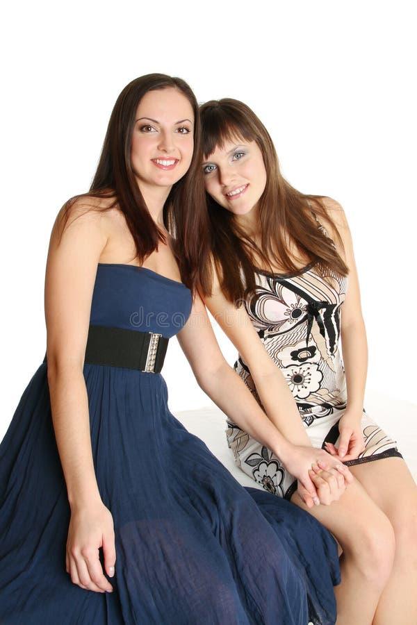 Twee meisjes in avondjurken stock afbeelding