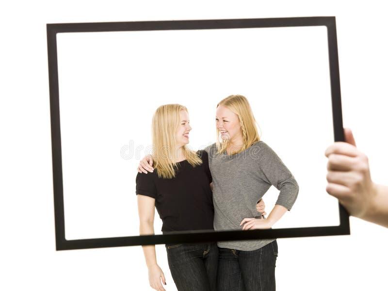 Twee meisjes in een frame royalty-vrije stock afbeelding