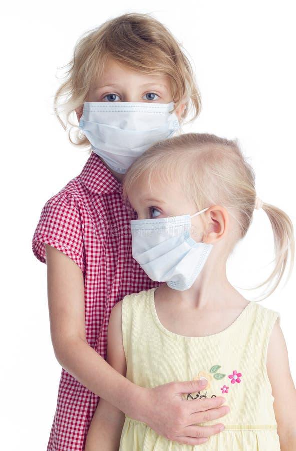 Download Twee Meisjes In Fase Maskeren Stock Afbeelding - Afbeelding bestaande uit bescherming, eenvoudig: 54080819
