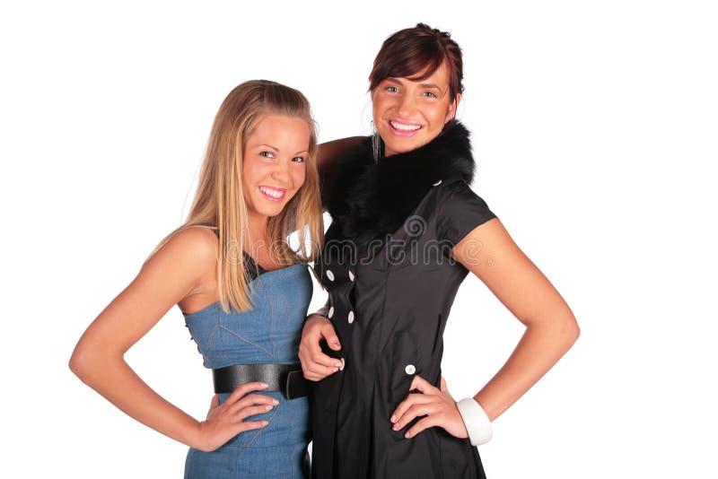 Twee meisjes het glimlachen stock afbeelding