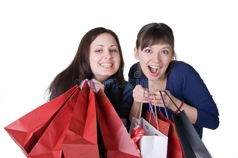 Twee meisjes met zakken stock afbeelding