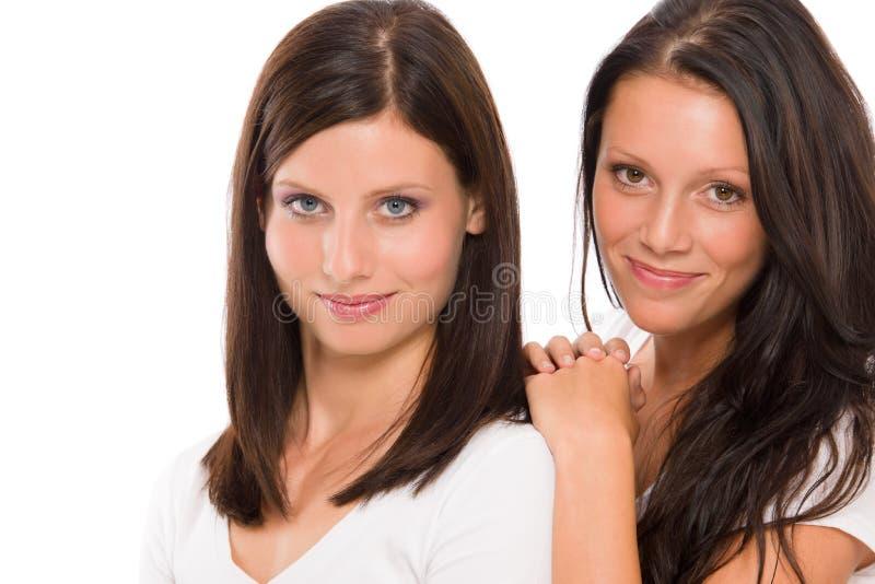 Twee meisjes mooi model het glimlachen portret royalty-vrije stock afbeelding