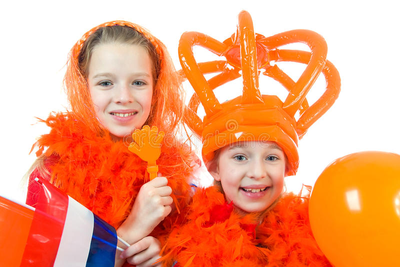 Twee meisjes stellen in oranje uitrusting stock fotografie
