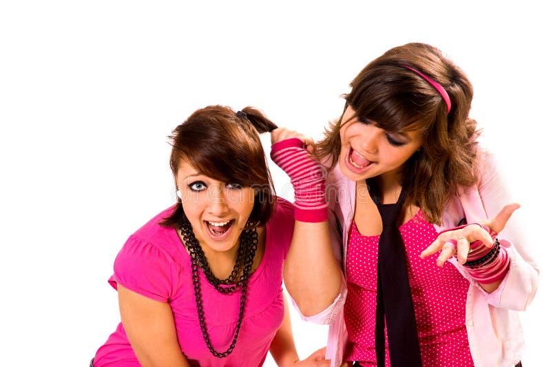 Twee meisjestienerjaren zweren royalty-vrije stock afbeelding