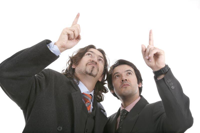 Twee mensen richten de vinger stock foto's