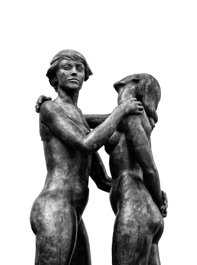 Twee omhelsten vrouwen, naakte standbeelden stock afbeeldingen