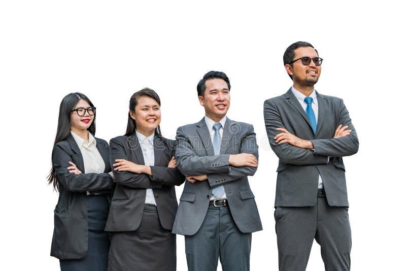 Twee onderneemsters en twee zakenlieden die een afstand met het glimlachen gezichten onderzoeken stock fotografie