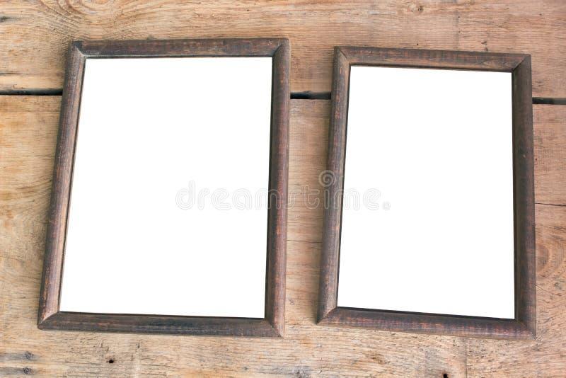 Twee oude fotoframes stock afbeelding