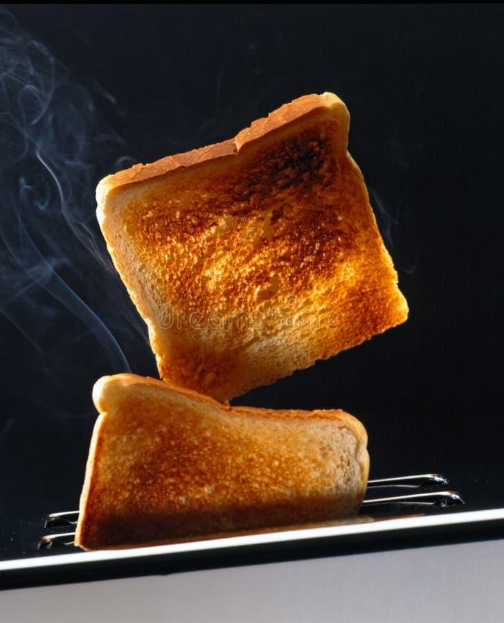 Twee plakken van toost in een broodrooster stock foto's