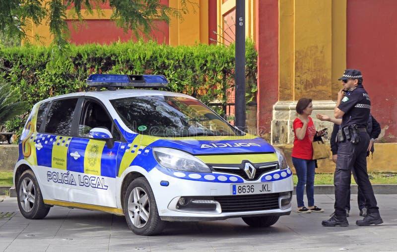 Twee politiemannen in de straat van Sevilla stock foto