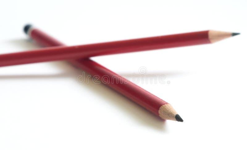 Twee potloden op witte achtergrond royalty-vrije stock foto's