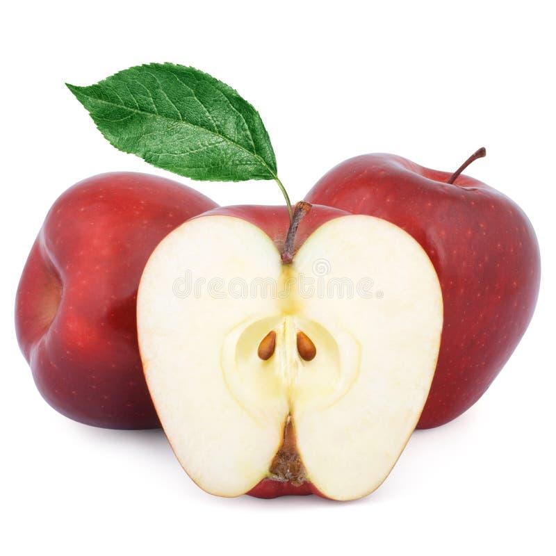 Twee rijpe rode appelen en half stock fotografie
