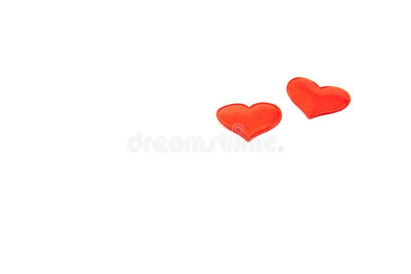 Twee rode harten op een geïsoleerde witte achtergrond De Dag van Valentine, 8 Maart, de dagconcept van vrouwen royalty-vrije stock fotografie