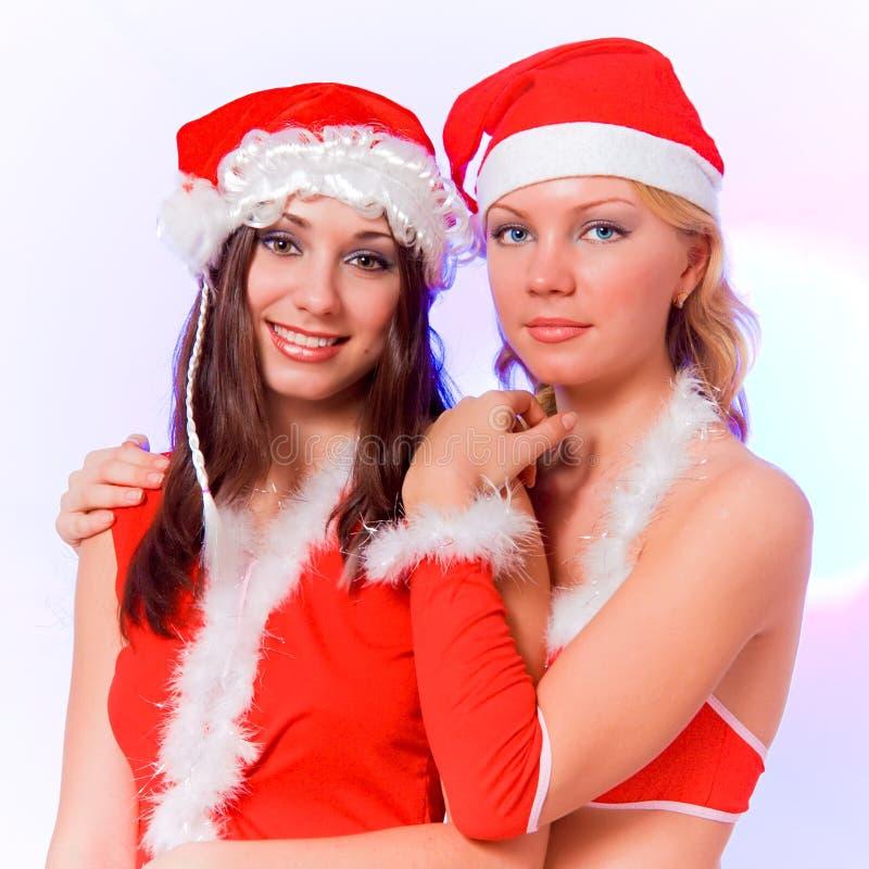 Twee sexy meisjes van de santahelper royalty-vrije stock foto